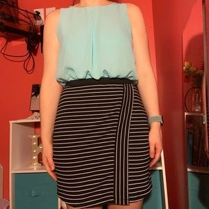 A turquoise and black and white striped dress